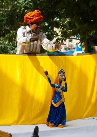 Banwari Lal blowing the reed with the puppet dancing