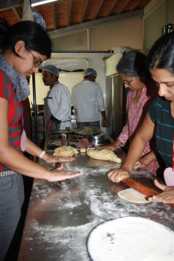 Few others making chapatis